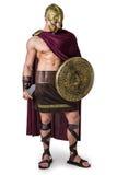 Ung muskulös man som poserar i gladiatordräkt Royaltyfri Foto