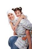 ung muslimkvinna i traditionell kläder med a Royaltyfri Bild