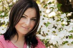 Ung nätt kvinna med blommor royaltyfria foton