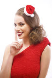 Ung nätt lycklig le brunettkvinna på jul i santas Arkivbilder