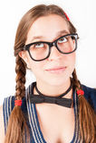Ung nerdy flicka som ser tänka upp Fotografering för Bildbyråer