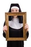 Ung nunna med den isolerade ramen Royaltyfri Foto