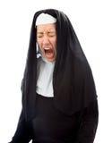 Ung nunna som ser frustrerad och ropa Arkivfoto
