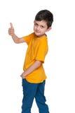 Ung pojke för mode med hans tumme upp Royaltyfri Bild