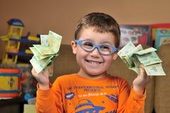 Ung pojke med pengar Royaltyfria Bilder