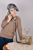 Ung pojke på den retro telefonen Royaltyfria Foton