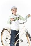 Ung pojke på en retro cykel Royaltyfria Bilder