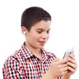 Ung pojke på internet Fotografering för Bildbyråer