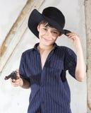 Ung pojke som en cowboy Arkivfoton