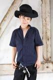 Ung pojke som en cowboy Arkivfoto