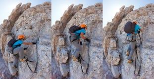 Ung pojke som klättrar a via ferrata i de italienska dolomitesna. royaltyfri bild
