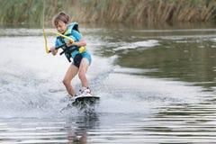 Ung pojke som wakeboarding Royaltyfri Fotografi