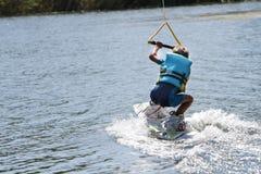 Ung pojke som wakeboarding Royaltyfria Foton
