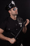 Ung polis i studio Royaltyfria Bilder