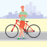 Ung röd hårhipster med cykeln Arkivbild