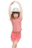 Ung rödhårig flicka i hatten Arkivbild
