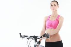 Ung sexig kvinna på en bicykle Arkivfoto