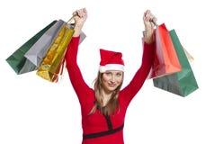 Ung shoppingkvinna med julhatten Arkivbild