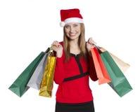 Ung shoppingkvinna med julhatten Arkivbilder