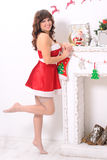 Ung sinnlig kvinna i klänning för nya år royaltyfri fotografi