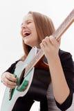 Härlig flicka med gitarren på vitbakgrund fotografering för bildbyråer