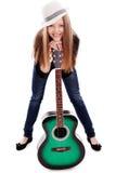 Härlig flicka med gitarren på vitbakgrund royaltyfri bild