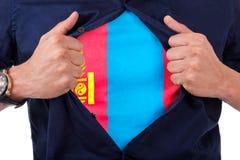 Ung sportfan som öppnar hans skjorta och visar flaggan hans räkning Royaltyfri Fotografi