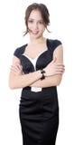 Ung standing och le för affärskvinna Arkivfoton