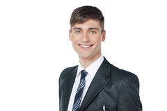Ung stilig affärsman med stort leende. Arkivfoto