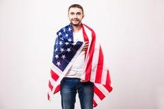 Ung stilig man med amerikanska flaggan Fotografering för Bildbyråer