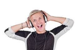 Ung stilig man som sjunger med hörlurar Fotografering för Bildbyråer