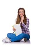Ung student med isolerade böcker Royaltyfria Bilder
