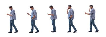 Ung student med smartphonen som isoleras p? vit royaltyfria bilder