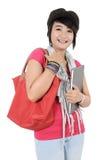 Ung student som rymmer en bok Arkivfoto