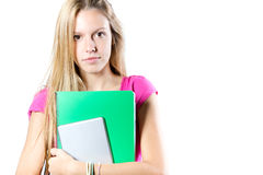 Ung studentkvinna med henne böcker på vit bakgrund Royaltyfri Foto