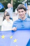 Ung utveckling av EU-entusiaster royaltyfria foton