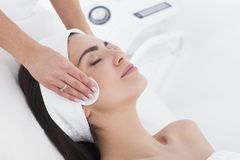 Ung Woman In Beautician Having A Facial Cleaning. Stock Photos