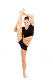Ung yrkesmässig gymnastkvinna Arkivfoto