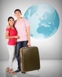 Unga asiatiska par reser runt om världen Arkivfoto