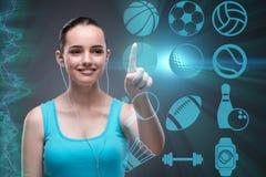 Unga flickan i trängande faktiska knappar för sportbegrepp Arkivbild
