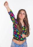 Unga flickan lyfter upp hennes hand Fotografering för Bildbyråer