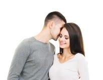 Unga och älskvärda par som isoleras på vit Arkivbild