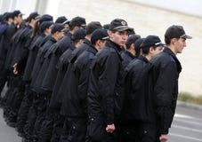 Unga poliser i bildande Royaltyfria Foton