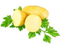 Unga potatisar, dekorera av persilja. Isolerat Royaltyfria Foton