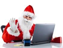 Unga Santa Claus med anteckningsboken royaltyfri foto