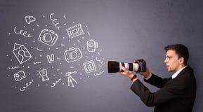 Unga symboler för fotografskyttefotografi Arkivfoton