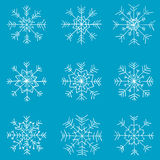 Ungar fastställda drog snowflakes Arkivbilder