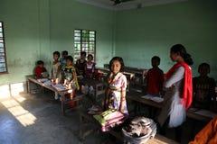 Ungar i skola Royaltyfria Foton