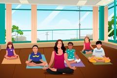 Ungar i yogagrupp Arkivfoton