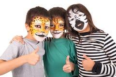 Ungar med framsida-målarfärg royaltyfri bild